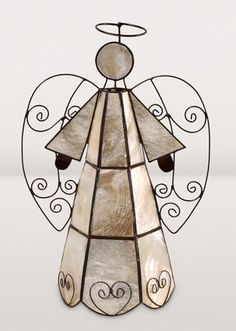 """Dyed capiz shell is the lovely translucent """"stained glass"""" shaping this angel. Capiz is the thin shell of a marine mollusk. Before glass became available in the Philippines, capiz was used for windows in houses."""