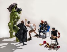 Hulk, Wolverine and Nick Fury put on a saucy show for Black Widow and Catwoman as a curiously coy Tony Stark sits it out. | This Photographer Puts Superhero Action Figures Into Awkward Poses