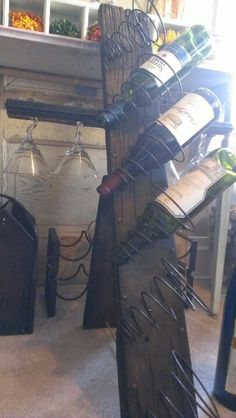 This wine rack was made from reclaimed wood and some rusty old bed springs...