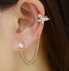 Butterfly Tassel Rhinestone Ear Cuff (Single, One Piecing) The latest hottest design! The tassel linked butterfly can be fastened with it's back hook anywhere on your ear. Ear Jewelry, Cute Jewelry, Body Jewelry, Jewelry Accessories, Women Jewelry, Jewelry Design, Silver Jewelry, Jewelry Sets, Silver Ring