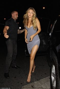 Model looks: Gigi Hadid wowed in a slinky grey dress as she headed to Kylie Jenner's 18th ...