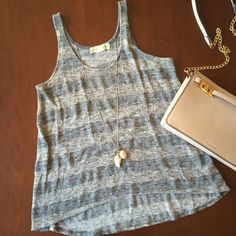 Metallic threaded knit tank top Striped knit tank top with metallic threading by Staring at Stars. Purchased at Urban Outfitters and only worn a few times. 60% polyester, 33% rayon, 4% metallic, 3% spandex. Urban Outfitters Tops Tank Tops