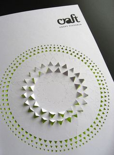 Annual Report for Craft Victoria. Reader can lift up pre-cut triangles, not much of a concept, could be applied in interesting ways.    Brooke