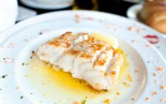 The delicate flavor of halibut fillets ensconced in the aroma of lemon scallion sauce cooked with the juice intact is the best way to serve this fish.