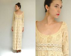 Not ivory or white, but a classic empire maxi with delicate cotton lace details just below the bust. The single long pleat in the front is simple and elegant. Chesty women like me would have to have more material up top, but it's a pretty understated style.