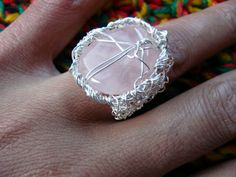 crocheted and knitted ring with silver plated wire (non tarnish) rose quartz gemstone.