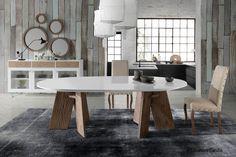 Mesa de comedor exclusiva de diseño único y atemporal, combinada con aparador estilo nórdico a juego con espejos en forma de círculos de diferentes tamaños