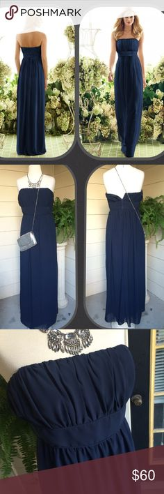 """🎉SALE🎉After Six navy georgette bridesmaid dress Style 6556 by After Six-straight strapless full length bridesmaid dress in Nu-Georgette. It features a shirred empire bodice & a column skirt. It's a current After Six style, retails at $198, color is Midnight (navy). Excellent condition. Buy this dress here for way cheaper!  NOTE-ALTERED AT TOP-bust is 34"""" (size 10 is 37"""" per After Six size chart). Waist-30"""", hips free flow. Length-50.5"""" I'm 5'10""""-it grazes my feet. It does zip up-my…"""