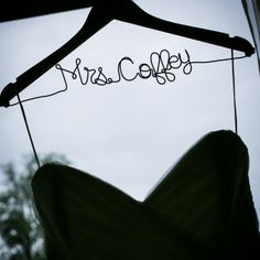 Such a cute idea! Have bride's new surname on hanger for wedding dress! @Four Seasons Bridal