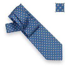 Hermes silk twill ties. Opt for whimsical patterns rather than the conspicuous H motif. Dark blues are best.