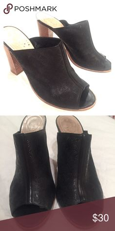 Club Monaco black leather heeled peep-toe mules Peep toe mules with stacked heel. Leather has a perforated floral design. Excellent used condition. Fits size 9 (shoe is size 40) Club Monaco Shoes Mules & Clogs