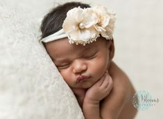 Newborn baby girl, timber pose, close up, pouty lips, flower headband, white and lace