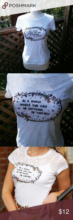 """White burnout t-shirt Super soft white burnout t-shirt. Wear with a cami underneath (does not come with one). Words """"In a world where you can be anything,  be yourself.""""  Juniors fitted sizes. Natural Life  Tops Tees - Short Sleeve"""