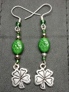 """2 1/2"""" Shamrock Dangle Earrings with Clover imprinted Glass Beads by BSODesigns on Etsy https://www.etsy.com/listing/219231040/2-12-shamrock-dangle-earrings-with... 