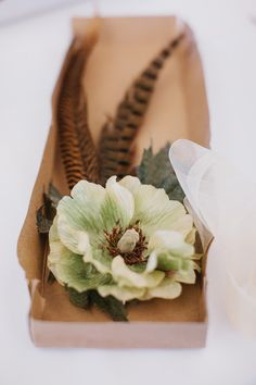 feather and floral bridal accessory // photo by AndrewThomasLee.com