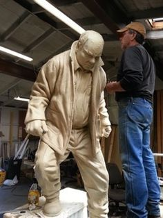 This sculpture is a tribute to those gentlemen who worked with their hands, proud of what they produced. Personal ambitions were sacrificed to better provide th