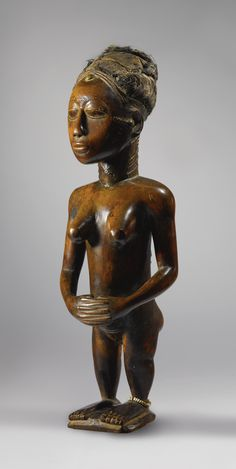 Baule Female Statue, Ivory Coast. This magnificent standing female figure is the work of an unknown Baule master, active in the 19th and early 20th century in central Ivory Coast. Sculptures by this artist are distinguished by the overall refinement of the carving and the fairly naturalistic body proportions.
