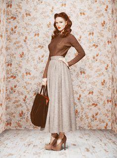 Ulyana Sergeenko - country tweed, velvet bag.