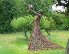 Twig lady.  Amazing work...