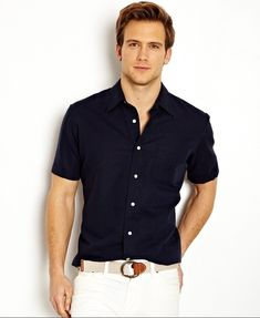 Shop this look for $101:  http://lookastic.com/men/looks/navy-shortsleeve-shirt-and-beige-canvas-belt-and-white-shorts/2121  — Navy Shortsleeve Shirt  — Beige Canvas Belt  — White Shorts