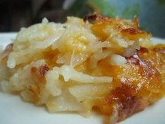 Cheesy Hashbrowns.  INGREDIENTS:        8-9 medium large potatoes OR 2 lbs. frozen shredded hashbrowns      2 cups shredded cheddar cheese (or any kind of cheese or mix of cheeses you prefer)      2 cups milk      4 Tablespoons butter (I only use 2!)      1 ½ teaspoons salt      Shredded Parmesan cheese