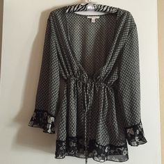 Sheer open blouse Sheer black blouse with tie around waist and detailing on the bottom and on the sleeves. Brand new, never worn! Tops Blouses