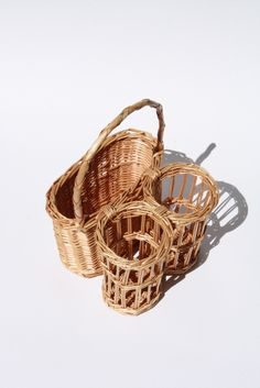 This vintage item is pre-loved and has been chosen for the unique  characteristics that come with time. Fading, wearing, and other  abnormalities display each item's history and add to its character and  charm. We hope you appreciate this piece as much as we do.     * Open Picnic Basket with Win
