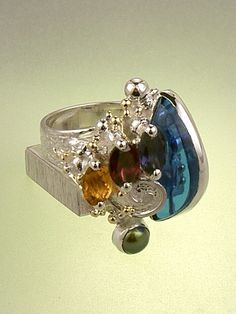 Piro cyber style ring in sterling silver, 18k gold with iolite, garnet, citrine, pearl, and glass