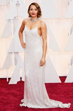 Carmen Ejogo is wearing a Houghton metallic mesh knit column gown at the 2015 Oscars