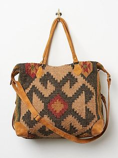 Savoy Weekender | The perfect weekender, made for fabulous getaways or local stays.  Colorful woven jute body with leather accents.  Zip top closure.  Inside features one zip pocket and cotton lining.  Top handles and one long adjustable strap for easy carrying.    *By Free People