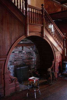beautiful wood staircase with cool brick fireplace underneath!  #home #decor