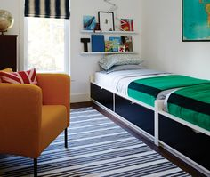 Abutting twin beds with built-in storage in the bedroom of senior design Sarah Hartill's son Tate won't eat up space so he can play freely on the floor with cars and Lego.