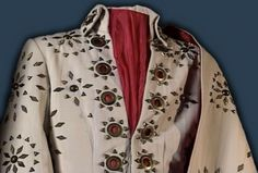 Today the White pinwheel suit is at Graceland but the belt was sold at the Hard rock cafe concession. in the 90'