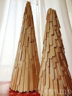 DIY Popsicle Stick Trees .. wouldn't it be fun if each stick was Mod Podge'd with holiday print paper first?  I LOVE that idea!