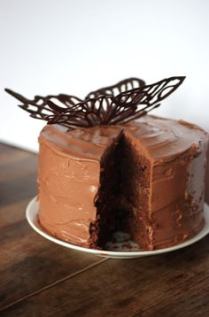 butterfly fleur de sel caramel cake (chocolate cake sandwiched with caramel and caramel chocolate whipped icing). topped with a beautiful delicate chocolate butterfly. Sweet Recipes, Cake Recipes, Dessert Recipes, Easy Desserts, Delicious Desserts, Caramel, Chocolate Desserts, Cake Chocolate, Melted Chocolate