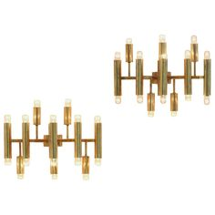 Pair of Elegant Italian Brass Candelabra Wall Lamps | From a unique collection of antique and modern wall lights and sconces at http://www.1stdibs.com/furniture/lighting/sconces-wall-lights/
