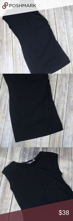"""Athleta Carefree Tee Dress Ruched Casual Modal Athleta Women's Carefree Tee Dress. Large. Black. Short sleeves with ruched sides. Still available online for $89. 57% pima cotton, 38% modal, 5% spandex. Machine wash. In good, preowned condition with no flaws noted. No trades.  From online: Measures approximately 18"""" pit to pit, 39"""" shoulder to hem.  INSPIRED FOR: adventure To Fro, adventure travel DOUBLE-LAYERED fabric gives you added coverage where you need it Wide straps for perfect bra…"""
