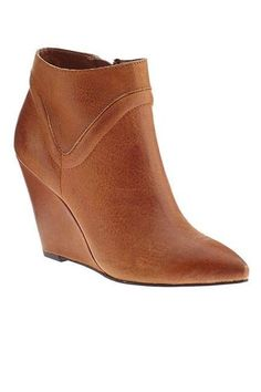 These tan brown wedge booties with the pointed toe are adorable! Love the wedge heel on these ankle boots, perfect with a cute skirt, dress, or pants for fall, winter and spring 2013 - 2014 ♥ Get this look at @SPARKTREND for $30, click the image to see! #ankle #boots #booties #wedges #shoes #womens #fashion