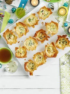 Impressive but easy, these delicate filo pies with parmesan, pancetta and spring onions make the perfect drinks party canapés.
