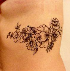 Floral rib tattoo