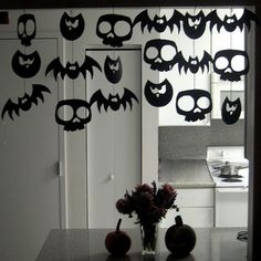 This creepy garland is easier to make than it looks! Blogger Anna Wulick simply printed three large Clipart images, attached them to yarn, then hung them with tape.