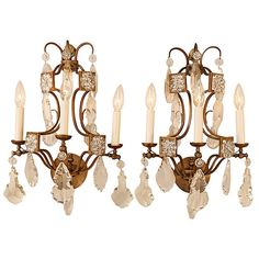 Pair of Crystal and Bronze Wall Sconces | From a unique collection of antique and modern wall lights and sconces at https://www.1stdibs.com/furniture/lighting/sconces-wall-lights/