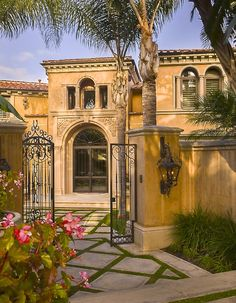 Mediterranean with charming iron-gated entry courtyard