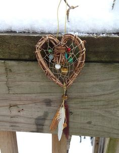 Colorful heart beaded wreath and feather dreamcatcher on Etsy, $14.00