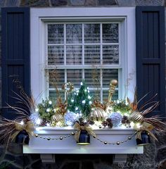 My Crafty Home Life: Updating My Window Boxes. I never thought of decorating my window boxes for Christmas but this is inspiring!