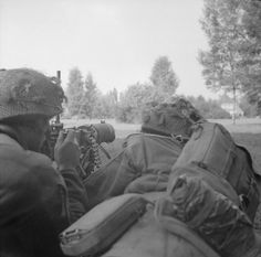 OPERATION 'MARKET GARDEN' - THE BATTLE FOR ARNHEM, SEPTEMBER 1944/ A heavy machine gun trained on houses in which snipers were located. © IWM (BU 1149)