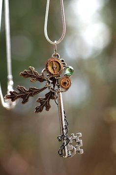 This is beautiful... I know it's a necklace but I would venture to put something like this in a scrapbook or even make it a Christmas ornament. I need... old chain, a broken watch, and maybe some metal leaves... Off I go to Scrapbook Generation!