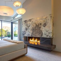 Luxury onyx fireplace ideas for your next design project. White, gold, brown, blue and black onyx design fireplace photos. Bedroom Fireplace, Home Fireplace, Fireplace Remodel, Modern Fireplace, Living Room With Fireplace, Fireplace Surrounds, Fireplace Ideas, Fireplaces, Contemporary Fireplace Designs