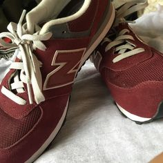 New Balance 574 Classic Shoes Burgundy runner type, brand new, never been worn. It is a men's size 7 and will definitely fit a women's size 8.5 or 9. Might be a tiny big on the 8.5 but perfect for size 9 New Balance Shoes Athletic Shoes