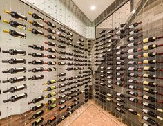 The CABLE WINE SYSTEM is the most versatile and sophisticated wine racking system available on the market. Comprised of cables made from the finest grade of stainless steel secured by top and bottom tension set mounts and connecting clamps made of solid brass with brushed nickel and chrome finishes, this superior and luxurious wine racking system is sure to enhance the visual impact and presentation of any wine collection or display.